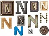 Alphabet made of wood, metal, plasticine. Letter N