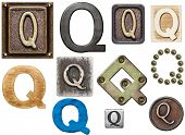 Alphabet made of wood, metal, plasticine. Letter Q