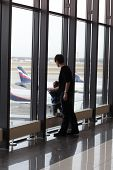 Mother With Son Looking At Airplane