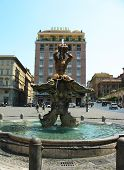 Fontana del Tritone in the front of Bernini Hotel at the Piazza Barberini in Rome