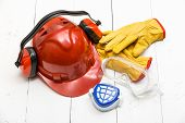 pic of protective eyewear  - Protective construction work wear on white table - JPG