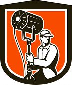 Electrical Lighting Technician With Spotlight Shield