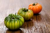 stock photo of crudites  - Red and green italian bovine heart tomatoes - JPG