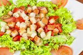 Vegetable salad with tomato, lettuce, cucumbers and croutons
