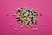 Mixed Dried Beans And Peas On A Pink Background