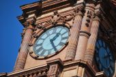 picture of amtrak  - A French Renaissance style red brick clock tower on a popular American train station against vibrant blue skies. ** Note: Slight graininess, best at smaller sizes - JPG