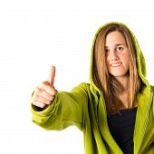 Young Girl With Thumb Up Over White Background
