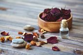 Rose petals and vial with rose essence