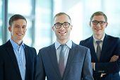 Team of three confident businessmen