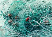 Detail of tangled green fishing nets