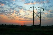 stock photo of transmission lines  - Transmission power line with sky background in the evening - JPG