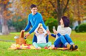 Laid-back Moment Of Family On Autumn Picnic