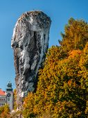 Limestone rock formation called Bludgeon of Hercules or Maczuga Herkulesa Renaissance Castle in Pies