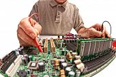 detail of computer technician at work