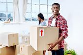 young black african couple moving boxes into new home together making a successful life