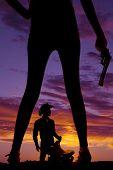 Silhouette Woman Legs Gun In Hand Cowboy