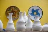 picture of pottery  - Shelves with ceramic dishware in pottery workshop - JPG