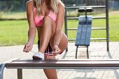 Active Woman Tying Her Shoes