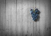 picture of stomp  - bunch of grapes on old wood and desaturated - JPG