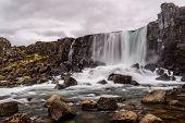Oxararfoss Waterfall In Pingvellir National Park In Iceland