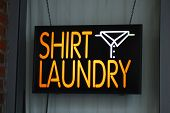 A neon sign of the shirt laundry shop