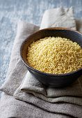 foto of millet  - Organic Millet Gruel in a Ceramic Bowl - JPG