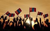 stock photo of mongolian  - Group of People Waving Mongolian Flags in Back Lit - JPG