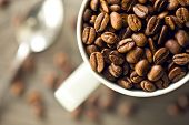 top view of coffee beans in mug