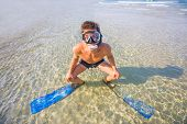 Man Snorkeling in the Caribbean Ocean