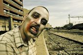 a scary zombie at abandoned railroad tracks, with a filter effect
