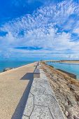 Road of breakwater and blue sky