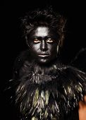 Woman with harpy makeup - mystical creature, isolated on black