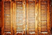 Vintage windows shutters background, closed aged wooden shutters, abstract rustic backdrop, retro house facade, old fashion building detail