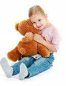 pic of montessori school  - Little girl hugging a teddy bear - JPG
