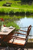 Vintage Wooden Table And Chair On Water Side
