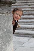 Girl playing peek a boo
