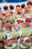pic of picking tray  - Close up Appetizing Fresh Fish Meat Finger Food with Tiny Stick For Easy Pick Up Served Together with Other Dishes - JPG