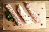 Italian salami on wooden background