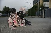 Male Zombie Crawling On His Knees, On Empty City Street