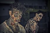 Two Male Zombies Standing Outdoor At Night For Halloween