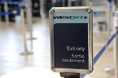 Vancouver, BC Canada - September 13,  2014 : Westjet exit only inside YVR airport in Vancouver BC Canada.