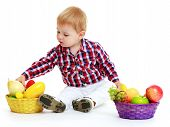 Little boy with a basket of fruit.