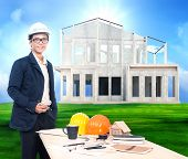 Engineering Man With Working Table And Home Project On Beautiful Green Grass Field Background Use Fo