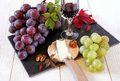 French Cheese, Grapes, Walnuts And Glass Of Red Wine