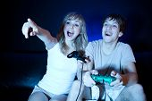 stock photo of video game  - A shot of a young couple playing video games in the living room - JPG