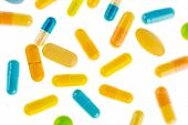 many tablets lying on a light background. symbol photo for medicine and drugs the pharmaceutical industry