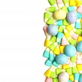 picture of easter candy  - Easter candy border over a white background - JPG