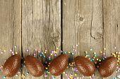 Chocolate Easter egg border on wood