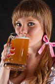 portrait beautiful woman Oktoberfest drinks beer