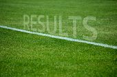 Football Results text on grass with white lane